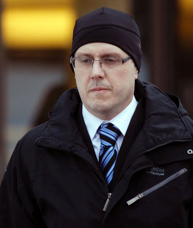 Phillip Nolan walks out of the Ottawa Courthouse on Thursday Feb. 6, 2014. (Darren Brown/QMI Agency)