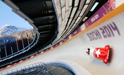 Switzerland's two-women bobsleigh pilot Fabienne Meyer speeds down the track during unofficial progressive training at the Sanki sliding centre in Rosa Khutor, a venue for the Sochi 2014 Winter Olympics near Sochi, February 6, 2014. (REUTERS/Fabrizio Bensch)