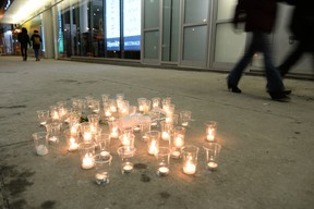 Candles sit where Alain Magloire, a homeless person, was shot in the street by the Montreal police February 4, 2014. (MAXIME DELAND/QMI AGENCY)