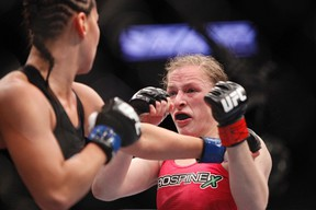 Sarah Kaufman (red gloves) fights against Jessica Eye (blue gloves) in their women's bantamweight bout during UFC 166 at Toyota Center on Oct 19, 2013 in Houston, TX, USA. (Andrew Richardson/USA TODAY Sports)