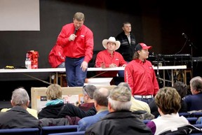 The team from Sekura Auctions once again took the helm at the Beehive Support Services Charity Auction held on Feb. 8 at the Life Church, taking bids on the donated items to raise money for the local organization.