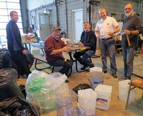 Mitchell Rotarians Mike Kraemer (left), Peter Huitema, Scott Wilson, Paul Van Gerwen and John Hohner prepare some lanterns which will be in use during the 4th annual Lantern Walk In The Woodlands next Sunday, Feb. 16. GERRY KEHL PHOTO