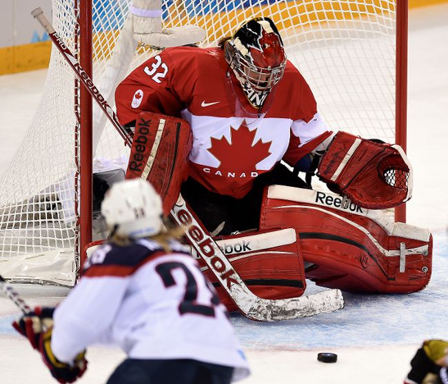 Charline Labonte (32) of Canada makes a save against Amanda Kessel (28) of USA during first period action action at the Shayba Arena in Women's hockey, in Sochi, Russia, on Wednesday February 12, 2014. Didier Debusschere/Journal de Quebec/Agence QMI