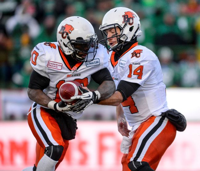BC Lions quarterback Travis Lulay hands off the ball to running back Stefan Logan during a game last season. 