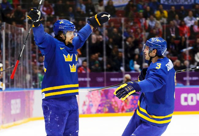 Sweden's Erik Karlsson (left) celebrates his goal with teammate Oliver Erkman-Larsson during their men's preliminary round hockey game against the Czech Republic at the Sochi 2014 Winter Olympic Games, Feb. 12, 2014. (MARK BLINCH/Reuters)