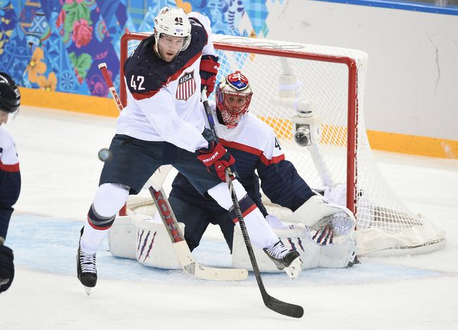 U.S. forward David Backes in front of Slovakia goalie Jaroslav Halak during their men's hockey round-robin game at the 2014 Winter Games in Sochi, Russia, Feb. 13, 2014. (BEN PELOSSE/QMI Agency)
