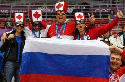 Team Canada fans await the start of the men's preliminary round ice hockey game against Norway at the Sochi 2014 Sochi Winter Olympics, February 13, 2014.   REUTERS/Mark Blinch