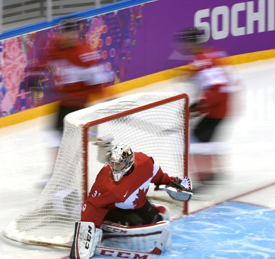 Carey Price Anahim Lake, BC blocking the puck during men's hockey, Canada vs. Norway at the 2014 Winter Games in Sochi Russia, on 12 february 2014.  Ben Pelosse/Le Journal de Montréal/Agence QMI