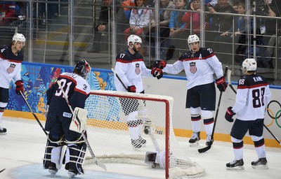 A goal of Dustin Brown of United States in front of Peter Budaj of Slovakia during men's hockey, USA vs. Slovakia t the 2014 Winter Games in Sochi Russia, on 12 february 2014.  Ben Pelosse/Le Journal de Montréal/Agence QMI OLY2014