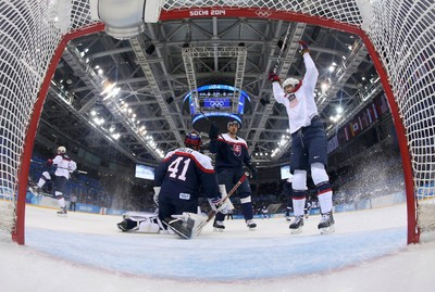 Team USA's John Carlson (L) celebrates his goal on Slovakia's goalie Jaroslav Halak (41) as Team USA's James van Riemsdyk (R) reacts during the first period of their men's preliminary round ice hockey game at the 2014 Winter Olympic Games, February 13, 2014.  REUTERS/Martin Rose/Pool (RUSSIA  - Tags: OLYMPICS SPORT ICE HOCKEY)