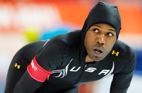 Shani Davis of the U.S. looks at his time after competing in the men's 1,000-metre speed skating race during the 2014 Sochi Winter Olympics, Feb. 12, 2014.  (PHIL NOBLE/Reuters)