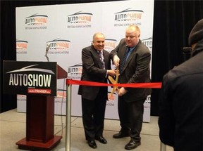 Rob Ford cuts ribbon to officially open the Canadian International Auto Show in Toronto. (DON PEAT/Toronto Sun)
