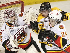 Belleville Bulls goalie Michael Giugovaz and defenceman Alex Yuill battle with Kingston Frontenacs forward Spencer Watson during OHL contest Monday afternoon in Kingston. (ELLIOT FERGUSON/Kingston Whig Standard)