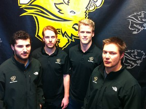 (Left to right) Joe Caligiuri, Ian Duval, Dane Crowley and Darren Bestland are four graduating members of the University of Manitoba Bisons men's hockey team that will host the Mount Royal Cougars of Calgary in Canada West best-of-three quarter-final playoff action, Feb. 21, 22 and 23 at Wayne Fleming Arena in Winnipeg. KIRK PENTON/Winnipeg Sun/QMI Agency