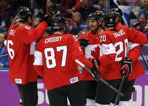 Canada's Drew Doughty (C) celebrates his goal on Finland with teammates during the first period of their men's preliminary round ice hockey game at the Sochi 2014 Winter Olympic Games February 16, 2014. (REUTERS)