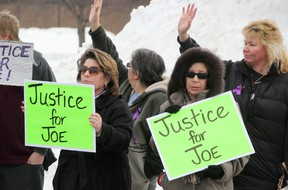 Stacey Grove, left, and Paula Foster were two of more than 20 people calling for stiffer animal cruelty penalties outside the Sarnia Courthouse Wednesday. A 19-year-old man charged with shooting a cat named Joe 17 times in the head with a pellet gun was appearing for a bail hearing. Group members wave as motorists honk in support. TYLER KULA/ THE OBSERVER/ QMI AGENCY