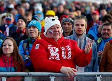 Russian fans watch a broadcast of the men's quarter-final match between Russia and Finland in the Olympic Park during the 2014 Winter Olympic Games in Sochi February 19, 2014. (REUTERS/Shamil Zhumatov)