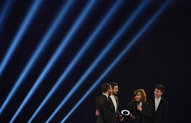 Members of Bastille react after being presented with the British Breakthrough Act award at the BRIT Awards, celebrating British pop music, at the O2 Arena in London February 19, 2014.  REUTERS/Toby Melville (BRITAIN - Tags: ENTERTAINMENT) (BRIT-WINNERS) FOR EDITORIAL USE ONLY. NOT FOR SALE FOR MARKETING OR ADVERTISING CAMPAIGNS