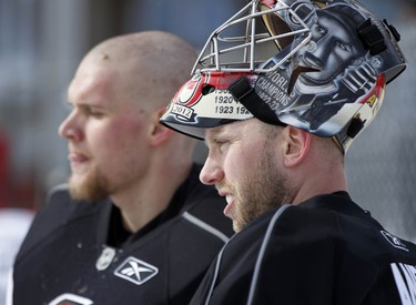 The Ottawa Senators hockey team took to the ice at Jules Morin Park in Ottawa for an outdoor practice on Thursday February 20, 2014. Goalies Robin Lehner, left, and Craig Anderson are photographed after practice. Darren Brown/Ottawa Sun/QMI Agency