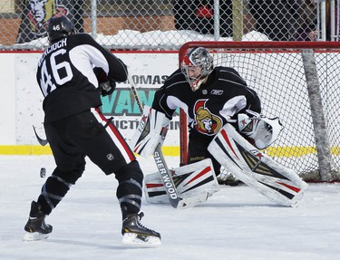 The Ottawa Senators hockey team took to the ice at Jules Morin Park in Ottawa for an outdoor practice on Thursday February 20, 2014. Patrick Wiercioch shoots on Craig Anderson during a shootout. Darren Brown/Ottawa Sun/QMI Agency