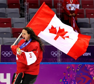 Team Canada goalie Shannon Szabados of Edmonton, AB., screams with joy as she carries her medal and a Canadain flag as she celebrated after beating Team USA 3-2 in overtime to win the women's ice hockey gold medal at the Bolshoy Ice Dome at the Sochi 2014 Winter Olympics in Sochi, Russia, on Thursday Feb. 20, 2014. Al Charest/Calgary Sun/QMI Agency OLY2014
