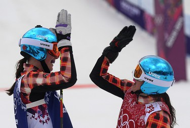 Canada's Marielle Thompson of Whistler, BC and Kelsey Serwa of Kelowna, BC celebrate their one, two finish for gold and silver medals with a high five in Ski Cross at the Rosa Khutor Extreme Park in Sochi, Russia, on Friday February 21, 2014. Didier Debusschere/Journal de Quebec/Agence QMI OLY2014