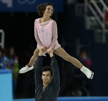 Meagan Duhamel of Lively, ON and  Eric Radford of Balmertown, ON , perform in the Figure Skating Pairs Short Program during the 2014 Winter Olympics  in Sochi, Russia, on Tuesday February 11, 2014. Al Charest/Calgary Sun/QMI Agency OLY2014