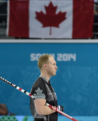 Canada's skip Brad Jacobs watches the play during men's Gold Medal curling against Great Britain at the Sochi 2014 Winter Olympics in Sochi, Russia, on Thursday Feb. 21, 2014. Ben Pelosse/Journal de Montreal/QMI Agency OLY2014