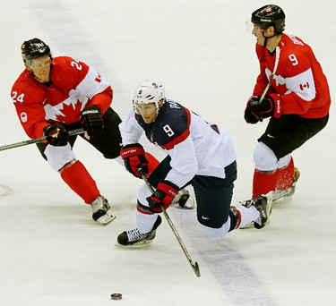 Team Canada's Corey Perry (324) and Matt Duchene (#9) chase Team USA's Zach Parise in the first period during the men's ice hockey semifinal playoff game at the Bolshoy Ice Dome during the Sochi 2014 Winter Olympics in Sochi, Russia, on Friday Feb. 21, 2014. Al Charest/Calgary Sun/QMI Agency OLY2014