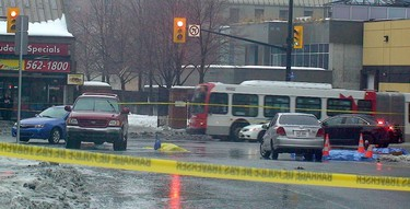 A 26-year-old woman is dead after she was hit by a transport truck at Waller St. and Rideau St. shortly after 6 a.m. on Friday, Feb. 21, 2014. Police are looking for the driver of a transport truck in connection with the crash.  (Danielle Bell/Ottawa Sun/QMI Agency)
