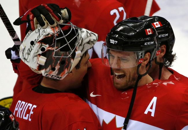 Canada's Shea Weber (R) celebrates with goalie Carey Price after Canada won their men's ice hockey semi-final game against Team USA at the 2014 Sochi Winter Olympic Games, February 21, 2014. (REUTERS/Grigory Dukor)