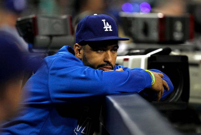 Los Angeles Dodgers center fielder Matt Kemp watches from the dugout in the first inning against the San Diego Padres in their MLB National League baseball game in San Diego, California September 20, 2013. (REUTERS/Alex Gallardo)
