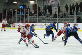 Thistles player Brandon Stanley moves the puck toward's the Thrashers' net while Vince Loschiavo closes in to take it from him during their playoff game at the Kenora Recreation Centre on Friday, Feb.21.