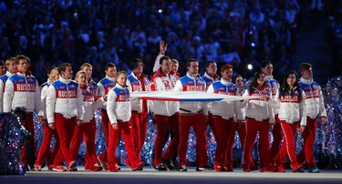 Russia's athletes carry their national flag in the closing ceremony for the Sochi 2014 Winter Olympic Games February 23, 2014.  (REUTERS)