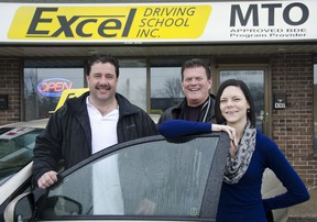 Excel Driving School co-owners Doug Dee (left) and Gerry Dion, with administrator Tabetha Miller, outside their main office at 1724 Bath Rd. The driving school is locally owned and operated since 1969. JULIA MCKAY/KINGSTON WHIG-STANDARD/QMI AGENCY