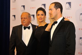Salma Hayek poses for a photo with her father, Sami, left and her brother, Sami Junior, right, at the Congressional Hispanic Caucus Institute 2013 gala at The Walter E. Washington Convention Center on October 2, 2013 in Washington, DC.  Larry French/Getty Images/AFP