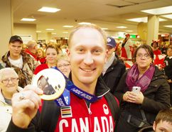 Brad Jacobs shows off his Olympic gold medal