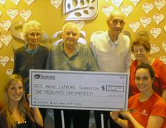 (Back row from left) Seasons residents Aileen Gooding, Jack Barnes, John Digsby, Joyce Giles joined with (front row) Brittany Kueneman of the Heart and Stroke Foundation and Rebecca Campbell, Seasons Strathroy lifestyle services manager to celebrate a donation to the organization to the tune of $1,105 recently. The final donation total – the result of a paper heart sale throughout February, aka Heart Month - has since reached $1,200. Contributed Photo