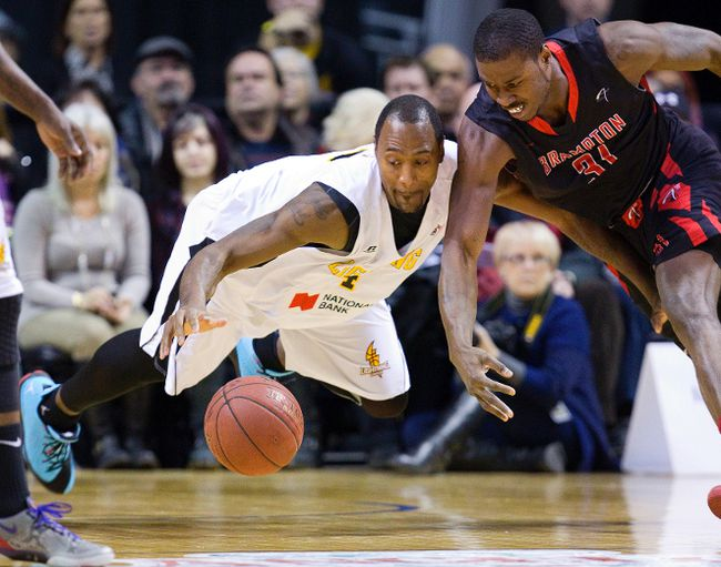 Elvin Mims of the London Lightning dives for a loose ball while guarding Flenard Whitfield of the Brampton A's during their game at Budweiser Gardens in London, Ont. on Thursday January 9, 2014. 