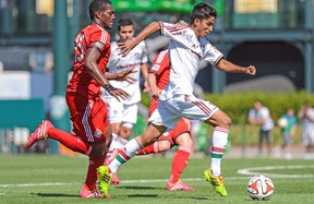 Fluminense's Igor Juliao and TFC's Doneil Henry chase down the ball during Saturday's game. (USA TODAY SPORTS)