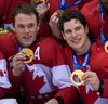 Team Canada's Jonathan Toews (left) and Sidney Crosby celebrate with their Olympic gold medals. (BEN PELOSSE/QMI AGENCY)