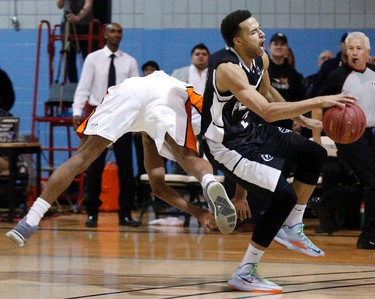 Ottawa SkyHawks' Justin Tubbs, left, tumbles after getting stripped of the ball from  Mississauga Power Morgan Lewis during NBL playoff action at La Cite Collegiale in Ottawa, Ont. on Sunday March 2, 2014. The Power advanced with a 103-100 win. Darren Brown/Ottawa Sun/QMI Agency
