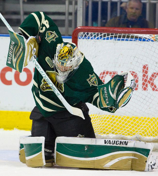 Anthony Stolarz stops a puck high on his blocker side with his shoulder as the London Knights as they hosted the Peterborough Petes at Budweiser Gardens in London, Ont. on Sunday March 2, 2014. 
