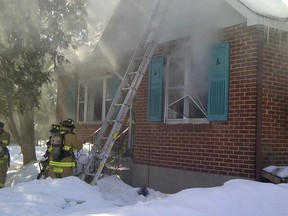 Ottawa firefighters battle a house fire on Tweedsmuir Ave. in the west end on Monday, March 3, 2014. No one was injured. (OTTAWA FIRE DEPARTMENT submitted image)