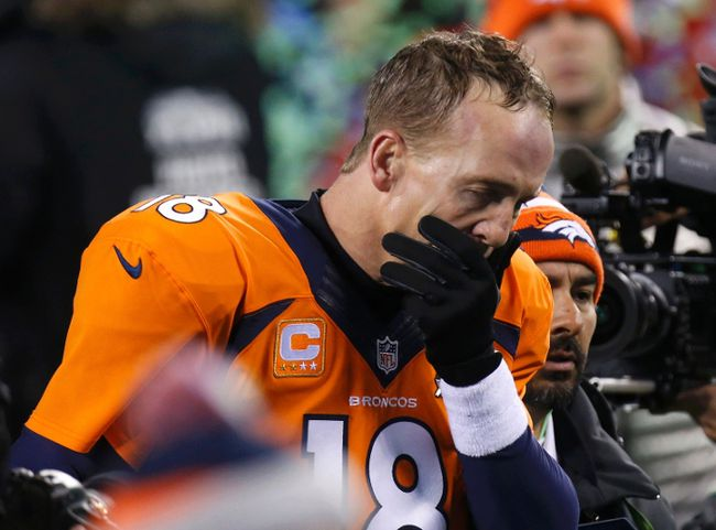 Denver Broncos quarterback Peyton Manning leaves the field after being defeated by the Seattle Seahawks in Super Bowl XLVIII in East Rutherford, New Jersey, February 2, 2014. (REUTERS/Brendan McDermid)