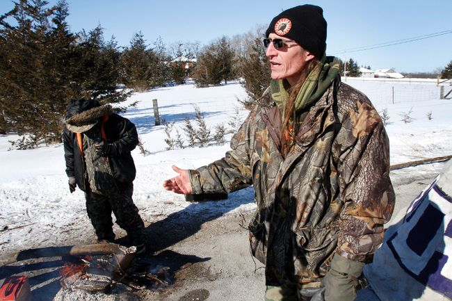 Mohawk activist Shawn Brant speaks with media near a teepee in the middle of Shannonville Road, south Hinchey Road and Airport Parkway, in Tyendinaga Township after he and less than a dozen protesters erected two barricades in the area Monday, March 3, 2014. - FILE PHOTO BY: JEROME LESSARD/The Intelligencer/QMI Agency