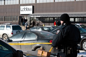 Edmonton Police Service officers investigate after two people were killed and four others injured in a multi-stabbing at a Loblaws Companies Limited warehouse at 16104 121A Avenue in Edmonton, Alta., on Friday, Feb. 28, 2014. Ian Kucerak/Edmonton Sun/QMI Agency