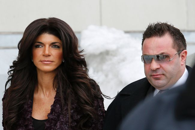 "Teresa Giudice, 41, (L) and her husband Giuseppe ""Joe"" Giudice, 43, exit the Federal Court in Newark, New Jersey, March 4, 2014. (REUTERS/Eduardo Munoz)"