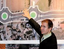 Consultant Shane Gray points to a pair of proposed roundabouts at the entrance to a shopping plaza and St. Michael Catholic School that are among seven proposed for a redevelopment of County Road 43 in North Grenville in this 2014 file photo. A petition started in July 2017 calls on the province to fund an expansion of the busy and sometimes unsafe roadway hrough the fast-growing community of Kemptville.