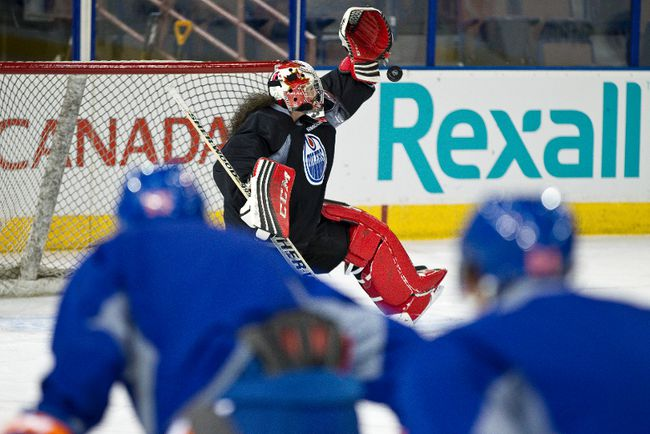 Team Canada goaltender Shannon Szabados (top)practices with the Edmonton Oilers at Rexall Place in Edmonton, Alta., on Wednesday, March 5, 2014. Szabados was part of the gold medal winning women's hockey team at the Sochi 2014 Winter Olympics in February. Ian Kucerak/Edmonton Sun/QMI Agency